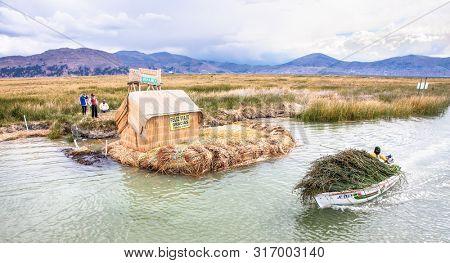 Titicaca, Peru- Jan 5, 2019: Local people traveling by boat at Titicaca lake near Puno, Peru, South America.