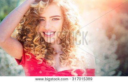 Spring Girl With Curly Hair Smiling. Beauty Hair Salon. Beauty Girl With Long And Shiny Curly Hair.