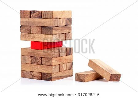 Stacked Wooden Block And Red Block On White Background. Symbol Of Leadership, Teamwork And Different
