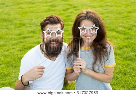 Fun Props. Funny Couple Holding Star-shaped Photobooth Props On Sticks. Happy Family Celebrating Wit