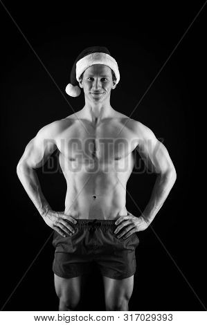 If you were bad girl. Handsome santa concept. Macho muscular torso posing confidently. Santa claus for adult girls. Sexy athletic macho muscular chest in santa claus hat. Athlete man wear santa hat. poster