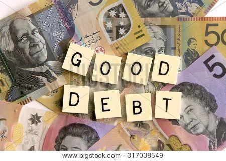 Good Debt Signage On A Background Of Austr Alian Dollar Notes.