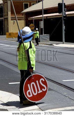 Traffic Warden Directing Traffic On Scott Street, Newcastle, Nsw, Australia