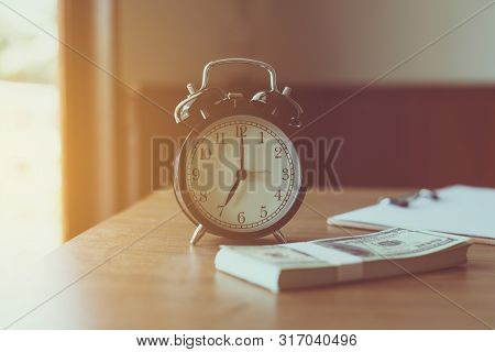 Close Up Of Modern Black Color Alarm Clock At 7 O'clock On Table In The Moning