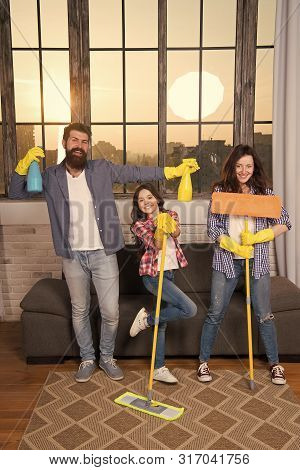 My Home Cleaned My Way. Family Clean House. Happy Family Hold Cleaning Products. Mother, Father And