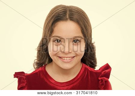 Kid Happy Cute Face With Adorable Curly Hair. Beauty Tips For Tidy Hair. Young Skin Care. Pure Beaut