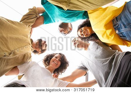 Happy Joyful Close Friends Hugging And Posing Outside. Bottom View Of Young Men And Women Standing I