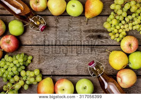 Homemade Apple Cider Vinegar Flatlay Of Fresh Ripe Apples Pears And Green Grapes Two Bottles Of Appl