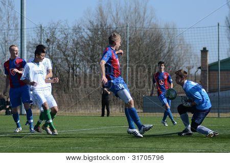 KAPOSVAR, HUNGARY - MARCH 17: Edvard Rusak (R) in action at the Hungarian National Championship under 18 game between Kaposvar(white)  and Videoton (blue) March 17, 2012 in Kaposvar, Hungary.
