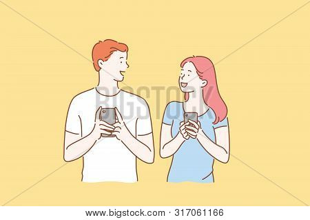Concept Of A Young Couple In Love Excited Man And Woman Smiling. Boy And Girl Meet Or Talk, Both Usi