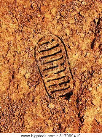 Astronaut Bootprint On Red Soil Mars Style Background