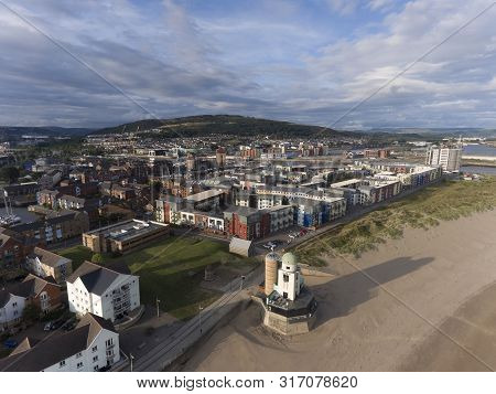 Editorial Swansea, Uk - August 11, 2019: Aerial Photo Of The Coastal Housing Development At The Mari