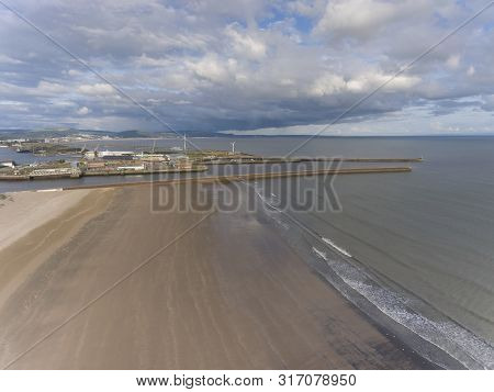 Editorial Swansea, Uk - August 11, 2019: Aerial View Of Swansea Bay, The East And West Piers And The