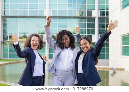 Happy Excited Businesswomen Rejoicing At Corporate Success. Team Of Women Wearing Office Suits, Maki