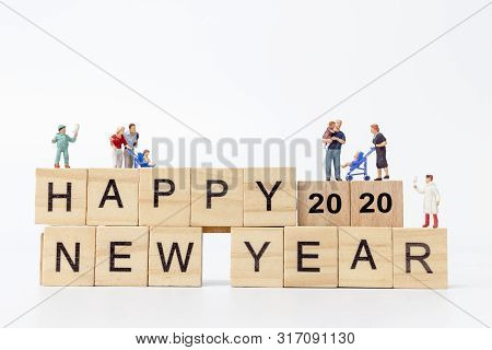 Miniature People : Happy Family Standing On Wooden Block  Happy New Year