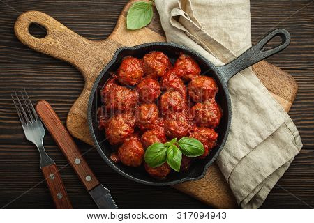 Top View Of Delicious Meatballs With Tomato Sauce And Fresh Basil In Cast Iron Rustic Vintage Pan Se