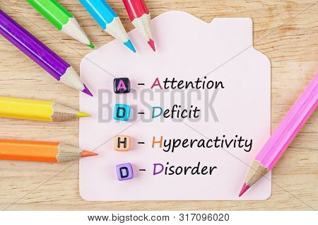 Attention Deficit Hyperactivity Disorder Or Adhd Concept With Colored Pencil Wooden.