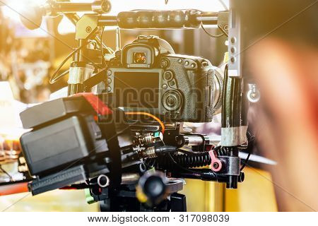 Film industry. cameraman shooting film scene with camera poster