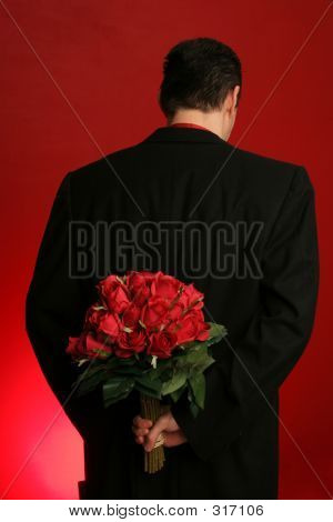 Man Holding Roses Behind His Back