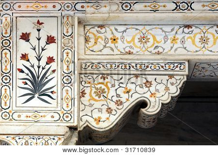 Details of polished marble surface is covered by stone inlay.