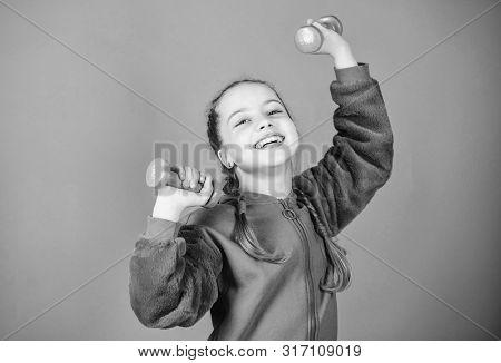 Toward healthier body. Rehabilitation concept. Girl exercising with dumbbell. Child hold little dumbbell violet background. Beginner dumbbell exercises. Sport for teens. Easy exercises with dumbbell poster