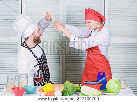 poster of Cooking with your spouse can strengthen relationships. Couple compete in culinary arts. Woman and bearded man culinary partners. Reasons why couples cooking together. Ultimate cooking challenge