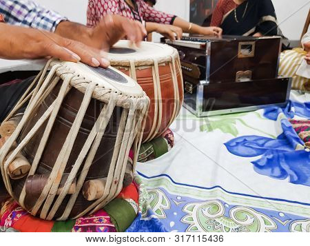 Close Up Image Of Musician Hand Playing Tabla, An Indian Classical Music Instrument With Focus On Fr