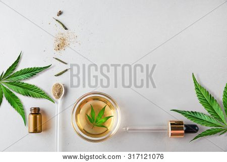 Glass Green Bottle And Pipette With Cbd Oil And Cannabis Leaf On Background. Minimal Concept. Flat L