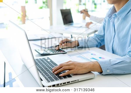 In office businessman in meeting analysis chart graphy marketing plan in business financial  audit project. Or Business adviser analyzing Budget. poster