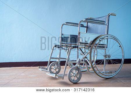 Modern Wheelchair In Empty Room,wheelchairs Waiting For Patient Services,space For Text.