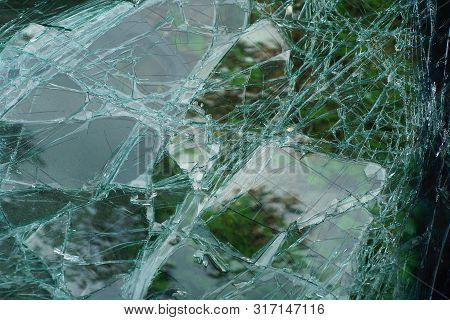 Light Green Glassy Texture Of Broken Glass With Cracks