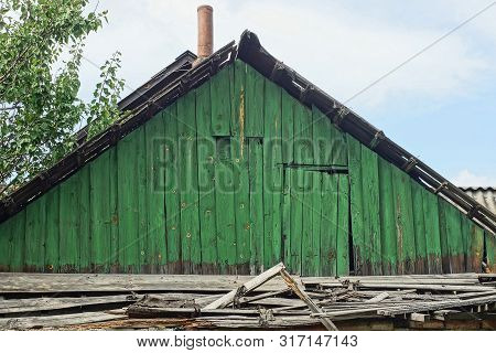 Old Green Wooden Loft With The Door Of A Rural House