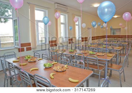 Kids Eating Lunch In A Social School Orphanage, Population Are Orphans, Due . Blue And Pink Balls On