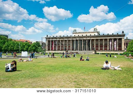 BERLIN, GERMANY - MAY 25, 2018: People at the Lustgarten park in the Museum Island, in the Mitte district of Berlin, Germany, in front of the Altes Museum, the Old Museum