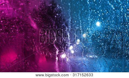 Rain Through The Glass With Neon Light
