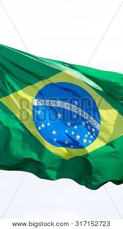 Brazil National Flag Textile Cloth Waving On Top, Blue Sky Brazil, Patriotism Concept.
