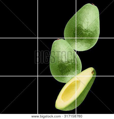 Falling Avocado Fruit Isolated On Black Background