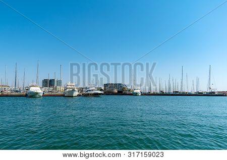 Sailboat Harbor, Many Beautiful Moored Sail Yachts In The Sea Port Stock Image