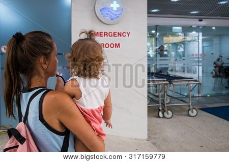 Mom And Child Come In In The Emergency Room At The Emergency Room In Hospital