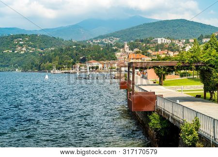 View Of Luino Lakefront Park On The Lake Maggiore In Hot Summer Day, Italy