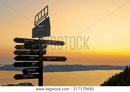 Beautiful Landscape With Signpost And Sunset Seen From The Top Of Mount Floyen In Bergen, Norway On