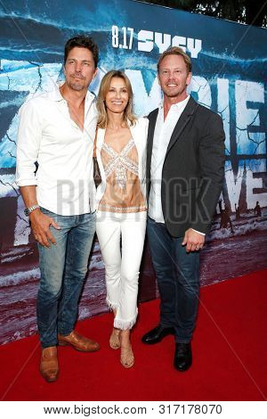 LOS ANGELES - AUG 12: Michael Trucco, Sandra Hess, Ian Ziering at the Premiere Of SyFy's