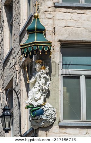 Antwerpen, Belgium - June 23, 2019: Closeup Of White Stone With Golden Crowns Statue Of Madonna With