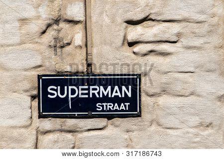 Antwerpen, Belgium - June 23, 2019: Closeup Of White On Blue Street Name Sign Of Suderman Straat Con