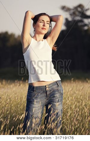 Outdoor portrait of a woman on a meadow releaxing
