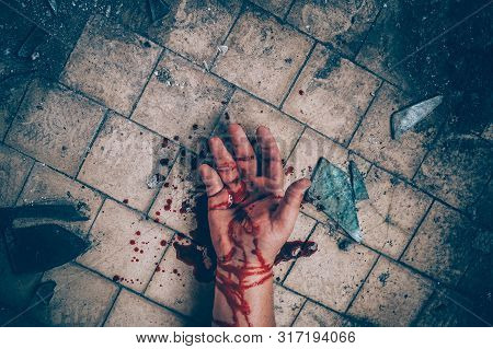 Crime Scene With Human Hand In Blood On Floor Of Killed Man By Murder, Dead Body Part Close Up, Tone