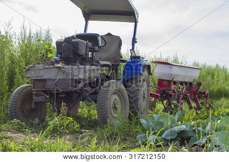 Macro Photo Transport Retro Vintage Tractor. Texture Background Blue Tractor With Trailer. Rural Old