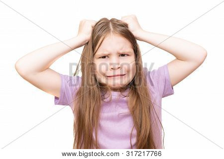 A Little Girl Pulls Her Hair. Isolated On A White Background. For Any Purposes