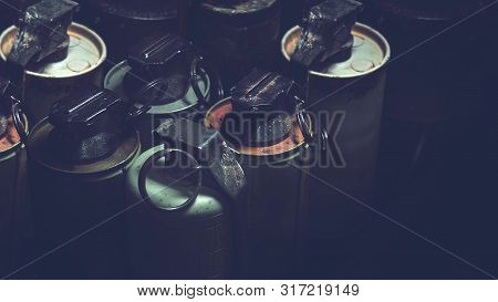 Old Hand Grenades In Box With Dark Background. Old Military Equipment In Vietnam War