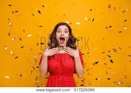 Pretty foxy lady surprised by unexpected birthday party arranging wear red dress isolated yellow background poster